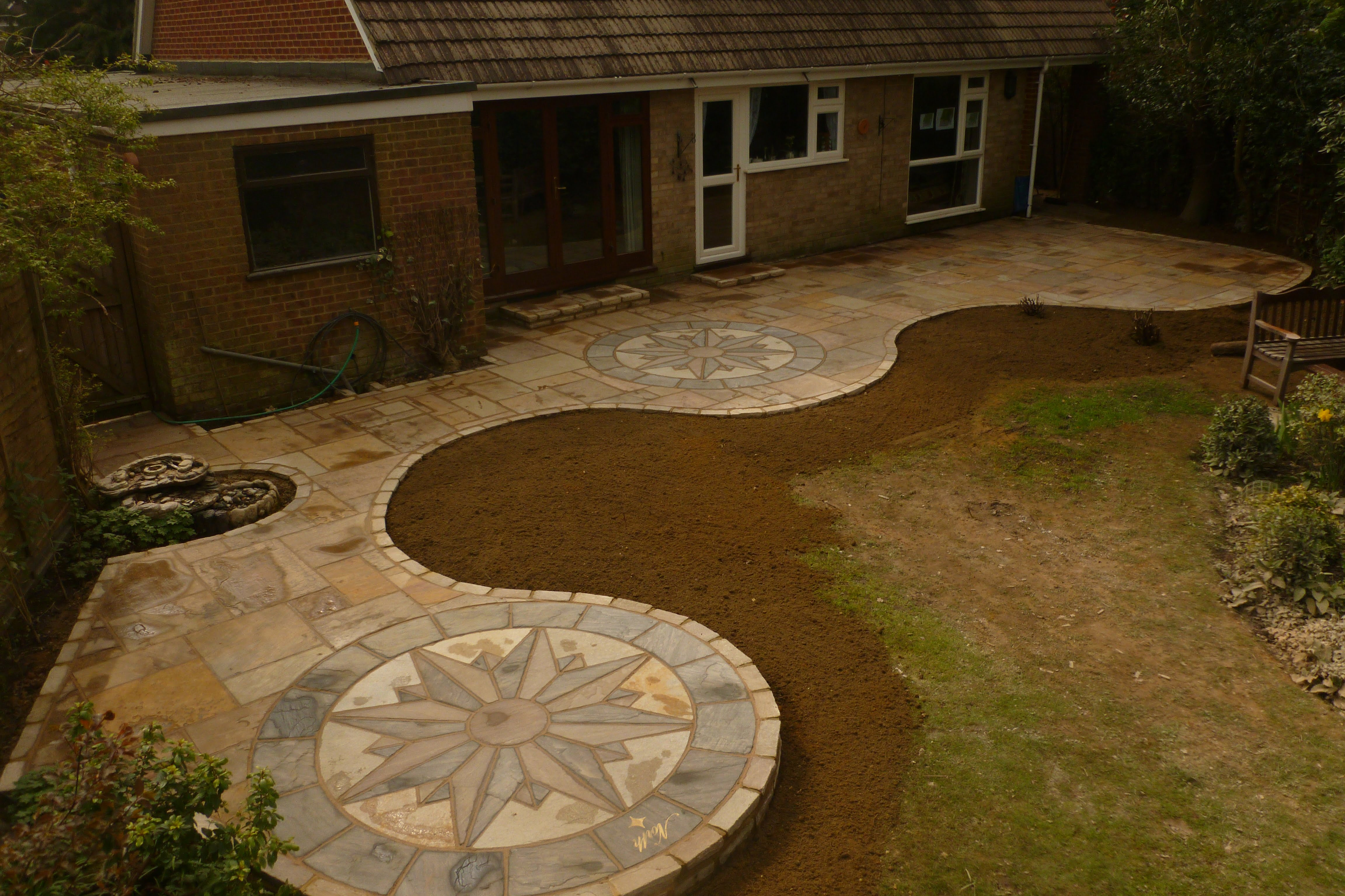 Stonemarket Vintage Abbey Earthern Paving with Vintage Compass Circles as installed by the landscape division