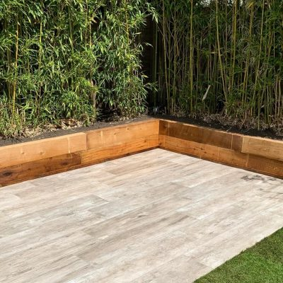 Softwood sleeper planters with porcelain paving