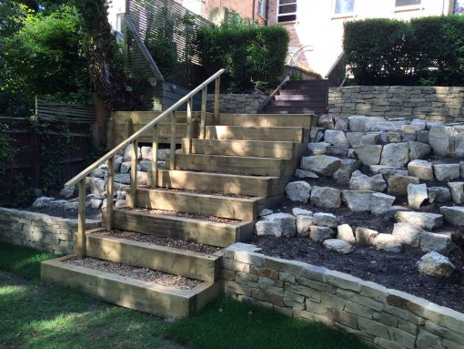 Large Purbeck rockery stones with dry stone walling and sleeper steps