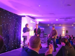 Matt Sharp and David Booton from the landscape division collect the prize from TV Celeb, David Domoney