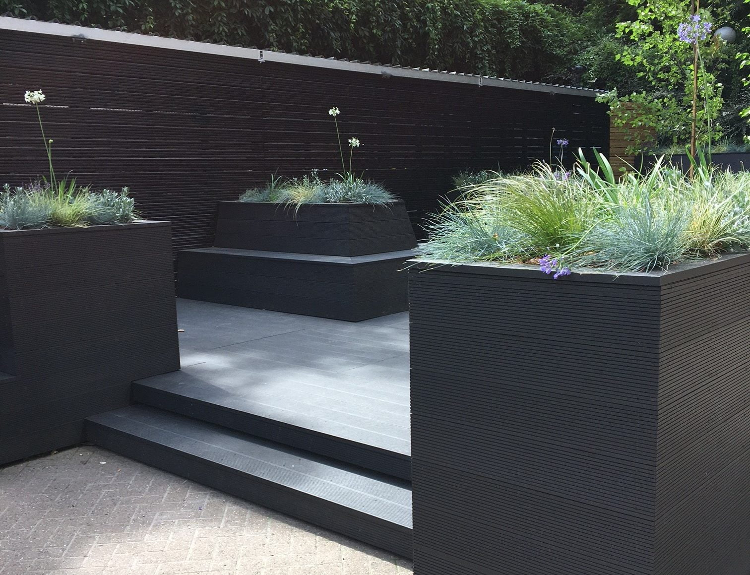 Dark grey composite deck with planters