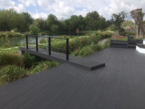 Charcoal decking and jetty by riverside