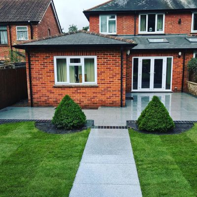 Natural Granite Light Grey (wet) installed by RE Landscapes