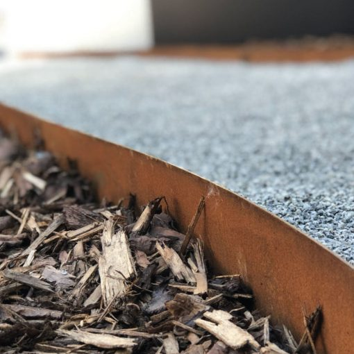 Core-ten weathered steel metal edging with bark chippings