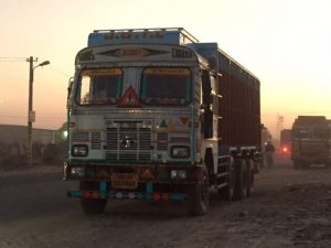 Goods vehicle carrying sandstone at sunset in Kota