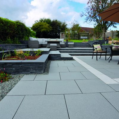 Pauta Mid Grey with Silver Grey porcelain patio with cladded walls