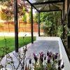 Thunderstorm porcelain paving with pergola shade