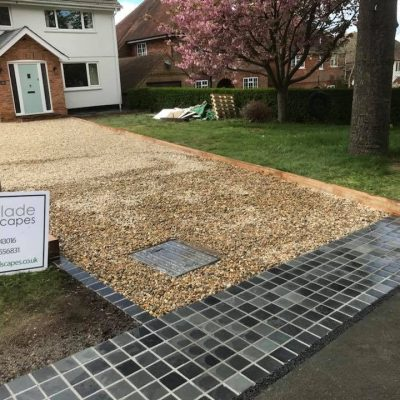 Brazilian Black Setts (wet) (installed by Winslade Landscapes)