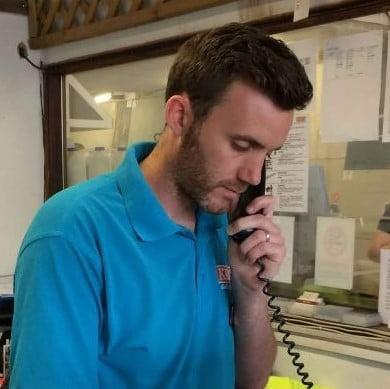 Kebur employee speaking to customer on phone