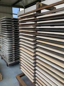Paving slabs drying in racks before sealing