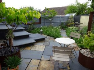 Rusty Slate paving in garden with naturalistic planting