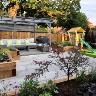 Garden with Silver Grey Sandstone, sleepers and decking