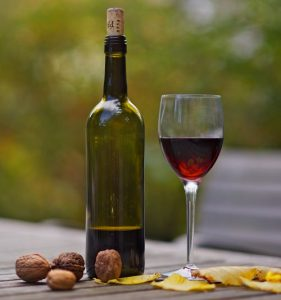 Wine glass and bottle outside