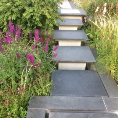 Black granite planks as edging and paving as steps