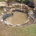 Filling a garden pond with water