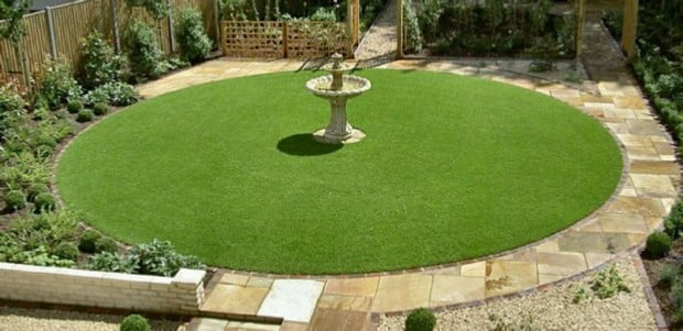 Round turf lawn surrounded by paving