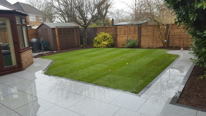 Garden with porcelain paving and turf