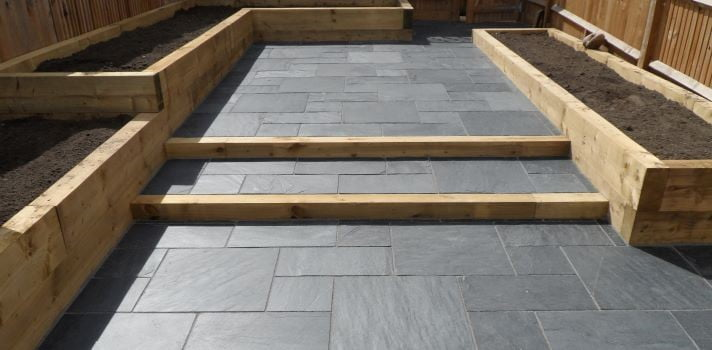 Slate paving with sleeper planters