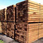 Treated brown hardwood sleepers.