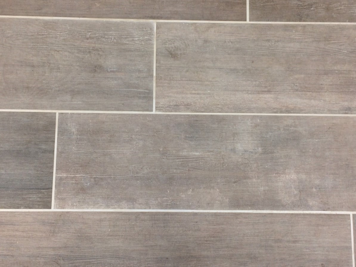 Porcelain tiles laid in a third bond laying pattern