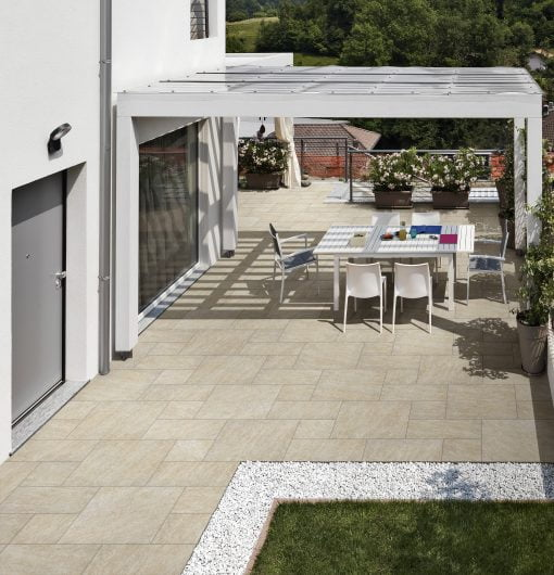 Modulo Quartz Gold modular porcelain paving with covered seating area