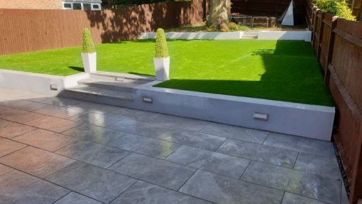 Nevis Grey porcelain patio with rendered walls