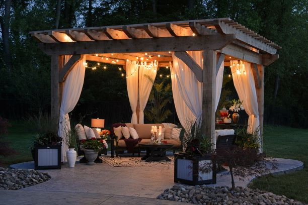 Pergola with white curtains and outdoor seating