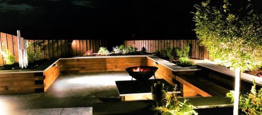 Garden seating area with spotlights