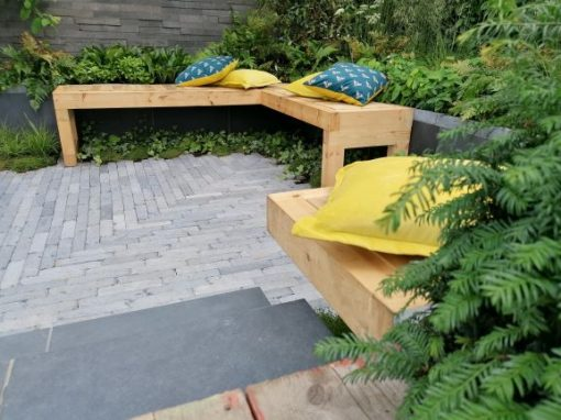 Sunken seating area with Asian Blue Tumbled Limestone setts
