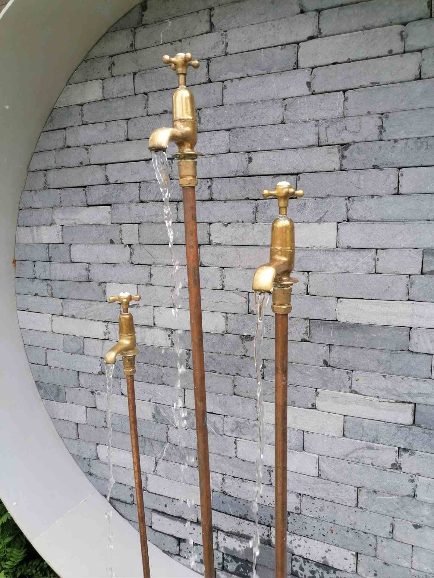 Re-used copper pipes and brass taps